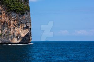 Speed Boat passing an Island by frozonfreak