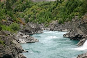 NZ Blue river, rocky edges, waterfall by Chunga-Stock