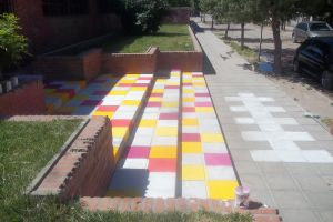 Gift of Colors for School-Street art in progress by Johnny-Aza