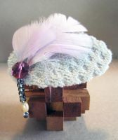 Purple Crystal with Pink Feathers on Aqua Velvet by spaceraptor