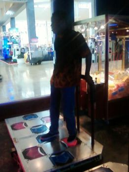 Me Playing DDR at the mall by Darkie-San