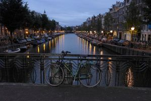 Bicycle Canal Bridge at Dusk by bobswin
