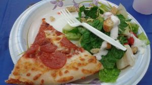 A slice of pizza and salad by mylesterlucky7