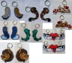 Some of the MANY keychain commissions i've done by nightspiritwing