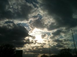 Sun beyond the clouds by sameera95