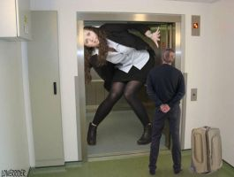 Tall Woman in elevator by lowerrider