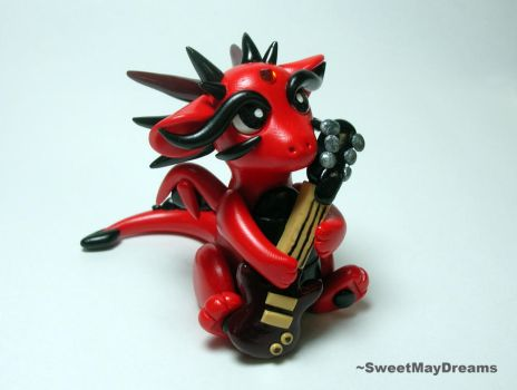 Dragon with Guitar by SweetMayDreams