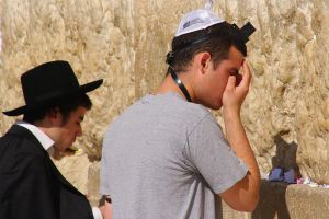 Religious Jews praying at the Western Wall by nikischlicki