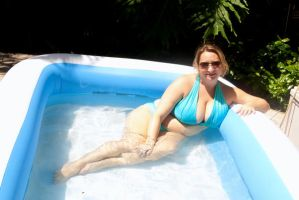 lounging in my pool by CurvyKrista