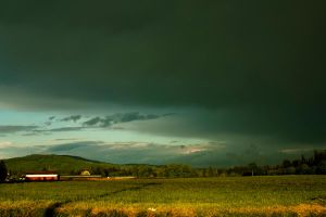 Stormy Sky Over Farm Land by designerfied