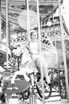 Bianca on a merry-go-round horse by JessyPhotography