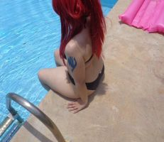 Refreshing before jumping in the pool by COSPLAYTITANIA