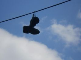 shoes on a telephone wire by audioslavekitty