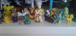 my pokemon figurines by WhippetWild