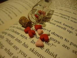 hearts in tiny bottles pendant by cutieexplosion