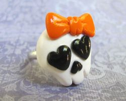Skull Ring with Orange Bow by DragonsAndBeasties
