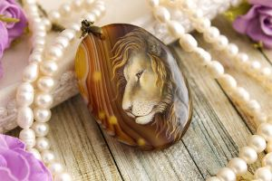 Lion - handmade painted stone pendant by LunarFerns