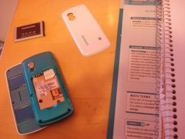 My poor severed phone by cali-cat