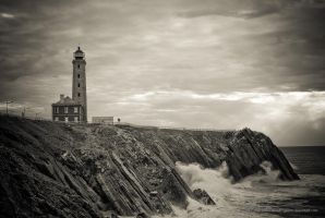 The Lighthouse and The Raging Sea by jpgmn