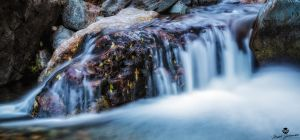 Flowing Off the Rock by mjohanson
