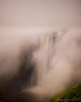 Water falls through mist by jmbroscombe