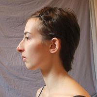 Face side view - hair pinned by CuriousPeaches