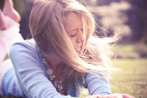 Sunlight Caught in Blonde Hair by escaped-emotions
