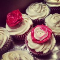 red velvet cupcake with cream cheese rose by raze36