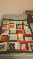 Scrappy baby quilt  by MinniBellSnow