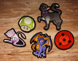 Batch of commissioned patches by goiku