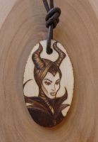 Pyrography Maleficent necklace by Somethings-Burning