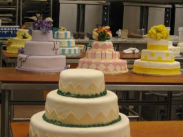 Wedding cakes on a table by IconicDreams