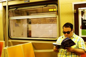 Reading on the Subway II by patrick-brian