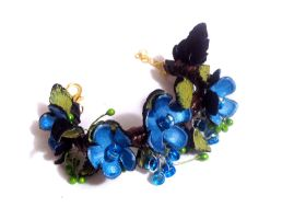 Statement bracelet with flowers. by julishland