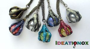 Crystal Ball and Claw Necklaces by Ideationox