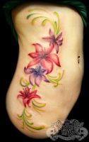 Lilies on ribs by state-of-art-tattoo
