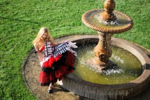 Alice by a fountain by Eveningarwen