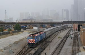 Metra leading A cloudy Chicago behind by JamesT4