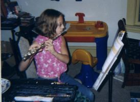 Hilary Playing Flute by fathernye