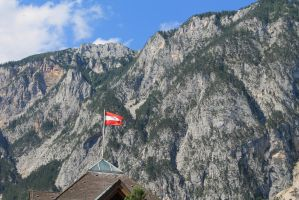 Flag in front of the mountains by LeniProduction