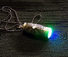 Color Changing Lighted Bullet Pendant by mymysticgems