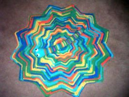 Round ripple afghan and snake toy by Nanettew9