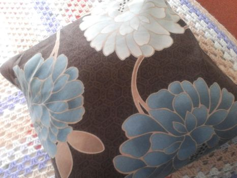 brown and blue flowers cushion by Alondra-chui