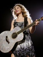 Taylor and her sparkly guitar by WonderTaylorstruck13