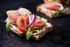Open sandwiches with ham, tomato and arugula by BeKaphoto