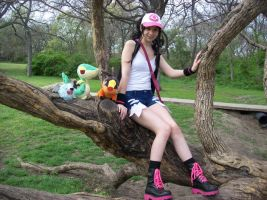 Trainer White and her Pkmn hanging on a limb. by Lokibelle