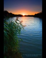 Sun Set Over Peatmore Lagoon by GMCPhotographics