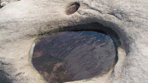 Water Puddle in Ancient Rock by KirstenStar