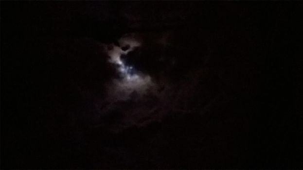 Moon behind the clouds by Spiniosa
