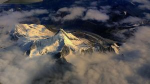Snow Mountain under sun by laogephoto